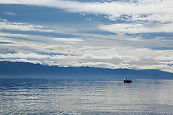 """Fishing Boat on Lake Tahoe 4"" - Photograph of a fishing boat on a very blue Lake Tahoe."