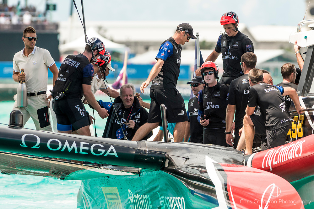 The Great Sound, Bermuda, 26th June 2017. Emirates Team New Zealand win race nine to win the America's Cup. Team Principal Matteo de Nora is congratulated by the sailors.