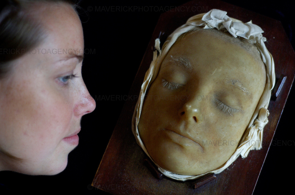 The death mask of Mary Queen of Scots was on display at Lyon and Turnbull today.  The mask made of wax will be on show to the public in a free exhibition there as part of the Edinburgh Festival.  Pictured Moira Gow Sales Administrator at Lion and Turnbull admires the mask...