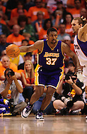 May 23, 2010; Phoenix, AZ, USA; Los Angeles Lakers forward Ron Artest (37) dribbles the ball during the first half in game three of the western conference finals in the 2010 NBA Playoffs at US Airways Center.  Mandatory Credit: Jennifer Stewart-US PRESSWIRE