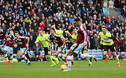 Burnley striker Andre Gray (7) scores from the penalty spot to make it 1-1 during the Sky Bet Championship match between Burnley and Brighton and Hove Albion at Turf Moor, Burnley, England on 22 November 2015.