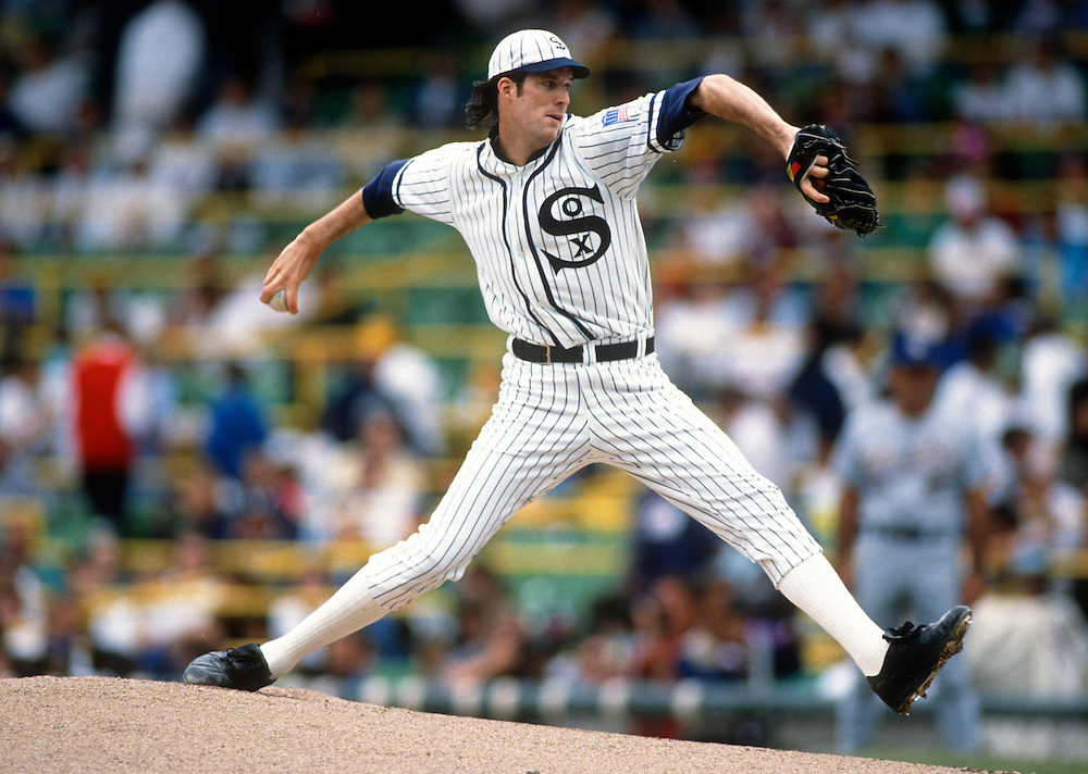 "CHICAGO - JULY 11:  Jack McDowell of the Chicago White Sox pitches during the first ""Turn Back the Clock"" game against the Milwaukee Brewers at Comiskey Park in Chicago, Illinois on July 11, 1990.  McDowell played for the White Sox from 1987-1994. (Photo by Ron Vesely)"