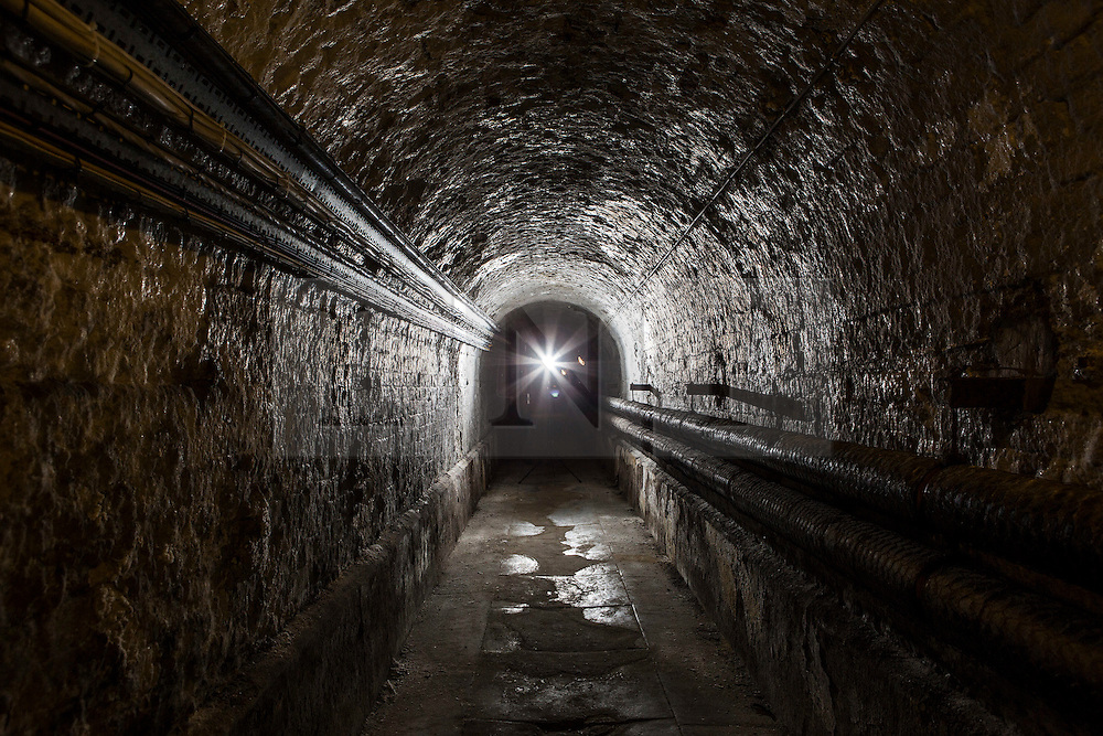© Licensed to London News Pictures. 23/06/2015. Leeds, UK. Rarely seen hidden Tudor tunnels & cellars of Temple Newsam house in Yorkshire. Picture shows one of the tunnels that runs under the house that would have been used by servants to get from one wing to another without being seen. Temple Newsam is famous as the birth place of Lord Darnley, notorious husband of Mary Queen of Scots. The Tudor-Jacobean mansion is set in 1,500 acres with grounds landscaped by Capability Brown. Photo credit : Andrew McCaren/LNP