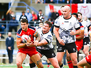 Jake Emmitt of Toronto Wolfpack  tackles Jay Pitts (L) of London Broncos during the Super 8s Qualifiers Million Pound Game at Lamport Stadium, Toronto, Canada<br /> Picture by Stephen Gaunt/Focus Images Ltd +447904 833202<br /> 07/10/2018