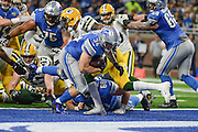 DETROIT, MI - JANUARY 01: Lions running back Zach Zenner (34) finds the end zone during a NFC North NFL football game between Detroit and Green Bay on January 1, 2017, at Ford Field in Detroit, MI. (Photo by Adam Ruff/Icon Sportswire)
