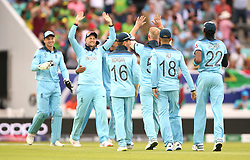 England's Ben Stokes (centre) celebrates the final wicket of South Africa's Imran Tahir with team-mates after the ICC Cricket World Cup group stage match at The Oval, London.