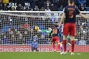 David Stockdale palms away an effort by Readings Glenn Murray during the Sky Bet Championship match between Brighton and Hove Albion and Reading at the American Express Community Stadium, Brighton and Hove, England on 26 December 2014.