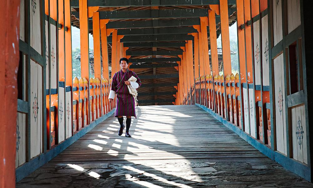 A man crossing the bridge toTrongsa Dzong, Bhutan.