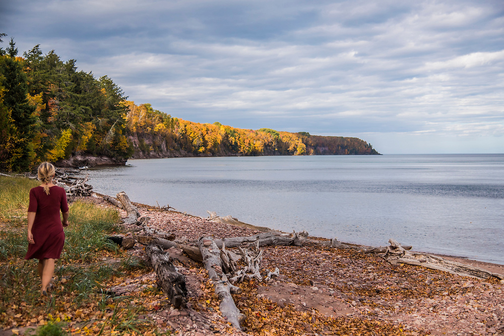 Exploring a Lake Superior beach in fall at Big Bay, Michigan.