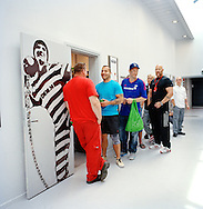 Halden Prison, Norway, June 2014:<br /> Inmates in line to shop for food in the prison grocery store.<br /> -- No commercial use --<br /> Photo: Knut Egil Wang/Moment/INSTITUTE