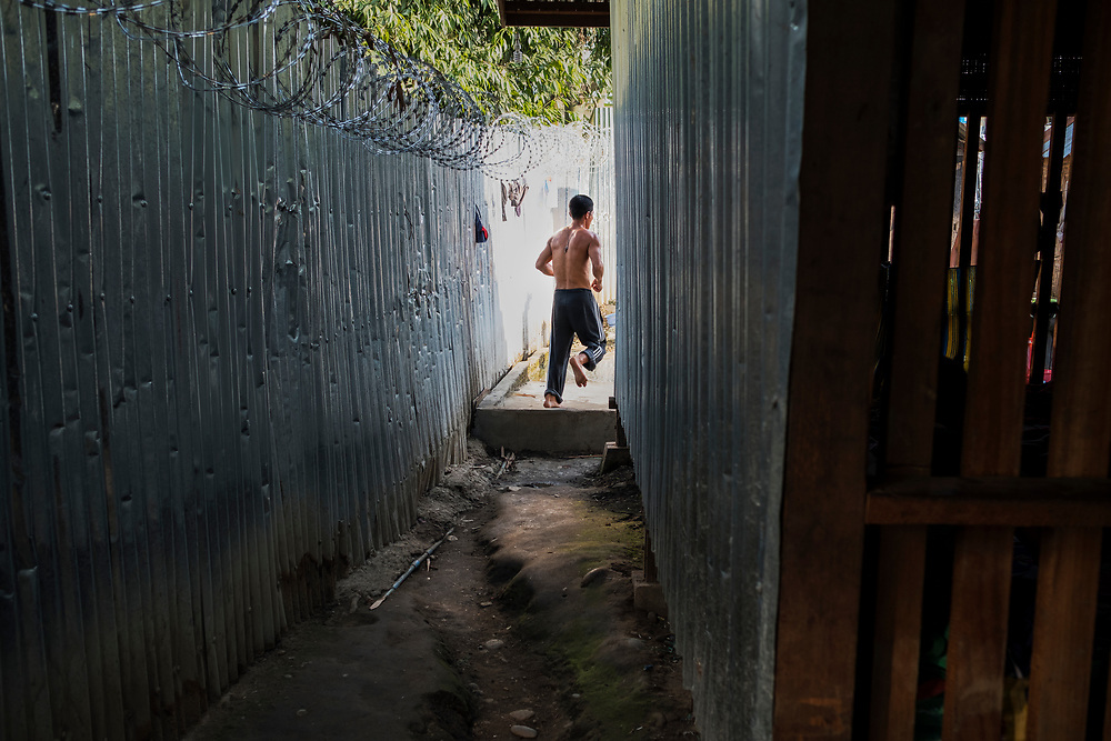 20170227 Myitkyina<br /> A client runs through an alley with barbed wire fencing at a Pat Jasan drug rehabilitation center in Myitkyina, Kachin state, Myanmar.<br /> Photo: Vilhelm Stokstad / Kontinent