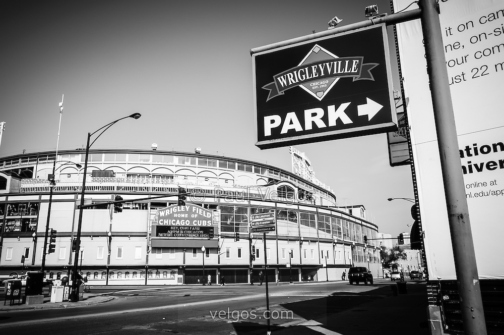 Wrigleyville Sign and Wrigley Field in Chicago in black and white. Home to the Chicago Cubs, Wrigley Field is one of the oldest baseball stadiums in the United States. Wrigleyville is a popular area of Chicago with a multitude of bars and restaurants.