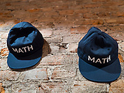 12 DECEMBER 2019 - DES MOINES, IOWA: MATH (Make America Think Harder) hats on the wall in Andrew Yang's office in Ames, IA. MATH is one of the slogans Yang's presidential campaign is using and many of his supporters wear them. Yang, an entrepreneur, is running for the Democratic nomination for the US Presidency in 2020. He brought bus tour to Ames, IA, Thursday. Iowa hosts the the first election event of the presidential election cycle. The Iowa Caucuses will be on Feb. 3, 2020.            PHOTO BY JACK KURTZ