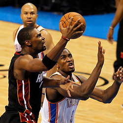 Jun 14, 2012; Oklahoma City, OK, USA;  Miami Heat power forward Chris Bosh (1) shoots against Oklahoma City Thunder power forward Serge Ibaka (9) during the second quarter of game two in the 2012 NBA Finals at Chesapeake Energy Arena. Mandatory Credit: Derick E. Hingle-US PRESSWIRE