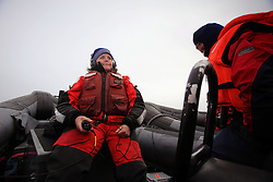 USA ALASKA CHUKCHI SEA 25JUL12 - Doctorate student Kelly Newman from the University of Alaska deploys a hydrophone from a Greenpeace inflatable boat to listen for whales in the area...Crew members survey the Chukchi Sea near a proposed Shell drill site north of Point Hope, Alaska.......Photo by Jiri Rezac / Greenpeace..© Jiri Rezac / Greenpeace