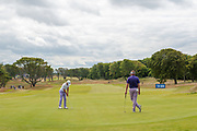 General view looking down the 2nd fairway as Justin Thomas (USA) putts, watched by Ian Poulter (ENG), during the final round of the Aberdeen Standard Investments Scottish Open at The Renaissance Club, North Berwick, Scotland on 14 July 2019.