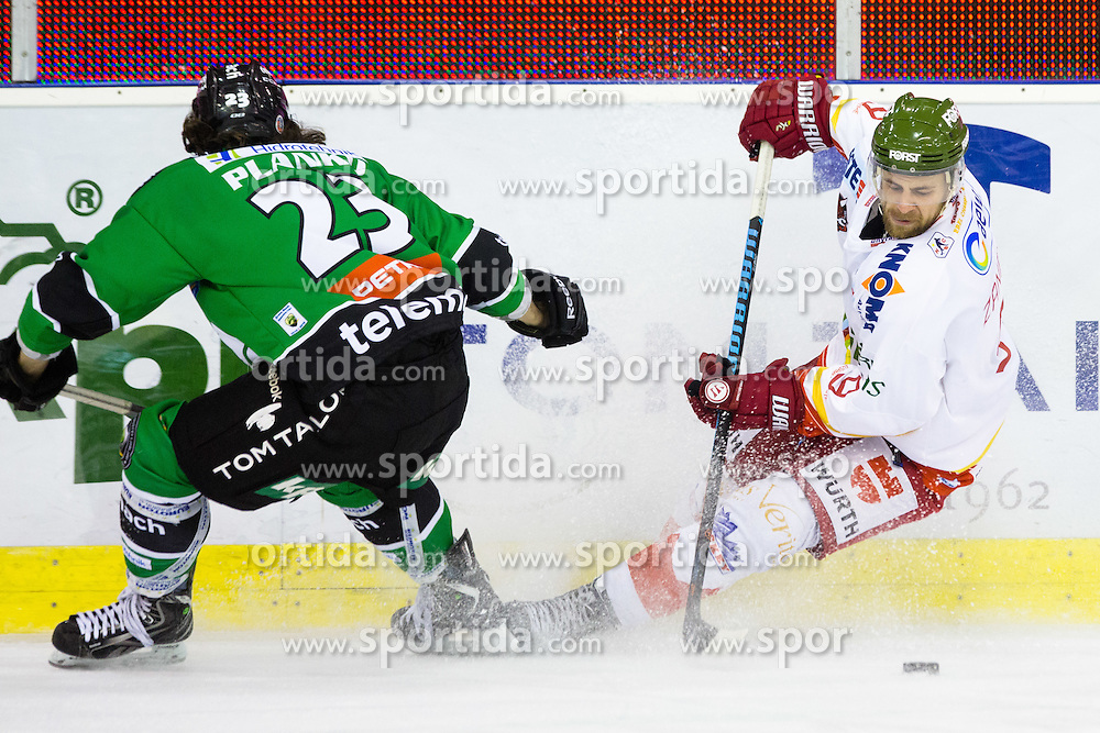 23.10.2014, Hala Tivoli, Ljubljana, SLO, EBEL, HDD Telemach Olimpija Ljubljana vs HC Bolzano Südtirol, 13. Runde, in picture Paul Zanette (HC Bolzano Sudtirol, #9) vs David Planko (HDD Telemach Olimpija, #23) during the Erste Bank Icehockey League 13. Round between HDD Telemach Olimpija Ljubljana and  HC Bolzano Südtirol at the Hala Tivoli, Ljubljana, Slovenia on 2014/10/23. Photo by Matic Klansek Velej / Sportida