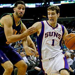 Feb 6, 2013; New Orleans, LA, USA; Phoenix Suns point guard Goran Dragic (1) drives past New Orleans Hornets point guard Greivis Vasquez (21) during the second half of a game at the New Orleans Arena. The Hornets defeated the Suns 93-84. Mandatory Credit: Derick E. Hingle-USA TODAY Sports