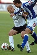 n/z.: Pawel Kaczorowski (nr26-Legia) , Matias Favano (nr24-Lech) podczas meczu ligowego Legia Warszawa (biale) - Lech Poznan (niebieskie-biale) 3:0 , I liga polska , 21 kolejka sezon 2004/2005 , pilka nozna , Polska , Warszawa , 07-05-2005 , fot.: Adam Nurkiewicz / mediasport..Pawel Kaczorowski (nr26-Legia) , Matias Favano (nr24-Lech) fight for the ball during Polish league first division soccer match in Warsaw. May 07, 2005 ; Legia Warsaw (white) - Lech Poznan (blue-white) 3:0 ; first division , 21 round season 2004/2005 , football , Poland , Warsaw ( Photo by Adam Nurkiewicz / mediasport )