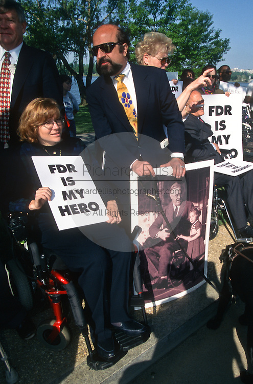 A protest by handicapped activists during the opening ceremony of the Franklin D. Roosevelt Memorial May 2, 1997 in Washington, DC. The memorial to the US 32nd president spreads across four granite-walled outdoor rooms along a 7.5 acre-swath of West Potomac Park.
