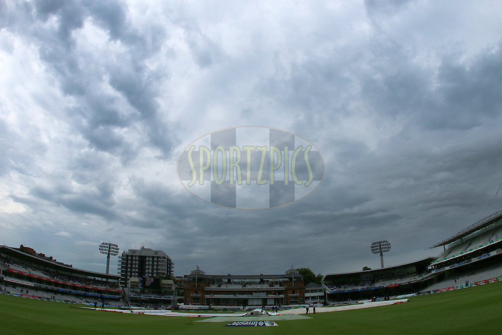 GV of the stadium in the rain during day three of the 2nd Investec test match between England and India held at Lords cricket ground in London, England on the 19th July 2014<br /> <br /> Photo by Ron Gaunt / SPORTZPICS/ BCCI