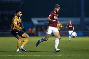 Charlie Goode and Daniel Powell in action during the EFL Sky Bet League 2 match between Northampton Town and Crewe Alexandra at the PTS Academy Stadium, Northampton, England on 16 November 2019.