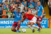 Jordan Clarke of Scunthorpe United battles with Keshi Anderson of Swindon Town during the EFL Sky Bet League 2 match between Scunthorpe United and Swindon Town at Sands Venue Stadium, Glanford Park, Scunthorpe, England on 3 August 2019.