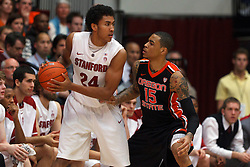 Feb 16, 2012; Stanford CA, USA; Stanford Cardinal forward Josh Huestis (24) is defended by Oregon State Beavers forward Eric Moreland (15) during the second half at Maples Pavilion. Stanford defeated Oregon State 87-82. Mandatory Credit: Jason O. Watson-US PRESSWIRE