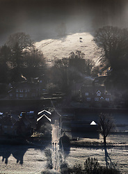 © Licensed to London News Pictures. 05/01/2017. Chilworth UK.  Early morning light on the houses in the village of Chilworth in the North Downs.  A continuing cold spell has seen temperatures as low as -6 in some areas. Photo credit: Peter Macdiarmid/LNP