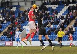 Bristol City's Aden Flint challenges for the ball with Colchester United's Sam Walker - Photo mandatory by-line: Dougie Allward/JMP - Mobile: 07966 386802 - 21/02/2015 - SPORT - Football - Colchester - Colchester Community Stadium - Colchester United v Bristol City - Sky Bet League One