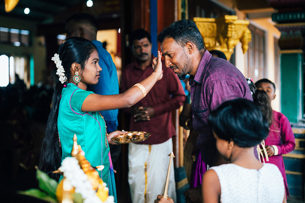 Hapatule, Sri Lanka -- February 3, 2018: Men and women arrive at a wedding at a small temple.