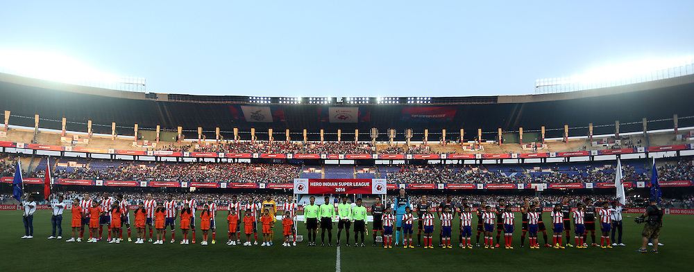 Teams stand for the National Anthem before the start of the match 7 of the Hero Indian Super League between Atletico de Kolkata<br /> and Delhi Dynamos held at the Salt Lake Stadium in Kolkata, West Bengal, India on the 19th October 2014.<br /> <br /> Photo by:  Sandeep Shetty/ ISL/ SPORTZPICS