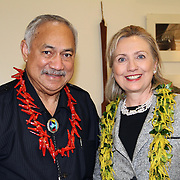 US Congressman Faleomavaega Eni Hunkin, visits with his longtime friend, US Secretary of State Hillary Clinton at the Tafuna Internaltional Airport, Governor's VIP Lounge, Tutuila, American Samoa.  Photo by Barry Markowitz, 11/8/10, 1am
