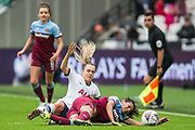 Josie Green (Capt) (Tottenham Hotspur) & Kenza Dali (West Ham) collide in a tackle during the FA Women's Super League match between West Ham United Women and Tottenham Hotspur Women at the London Stadium, London, England on 29 September 2019.