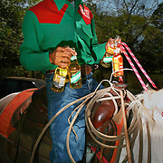 "On a scrotching midafternoon, a Cowboy brings beer to his teamates during a lasso competition in San Carlos, near Boquete, Panama, on February 11, 2007. In the competition, each heat features one town's team versus another in a tournament bracket style. The speed of the calf's capture determines points. ..""Cold Ones"""