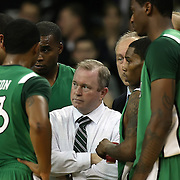 Marshall head coach Tom Herrion listens during a timeout in a Conference USA NCAA basketball game between the Marshall Thundering Herd and the Central Florida Knights at the UCF Arena on January 5, 2011 in Orlando, Florida. Central Florida won the game 65-58 and extended their record to 14-0.  (AP Photo/Alex Menendez)