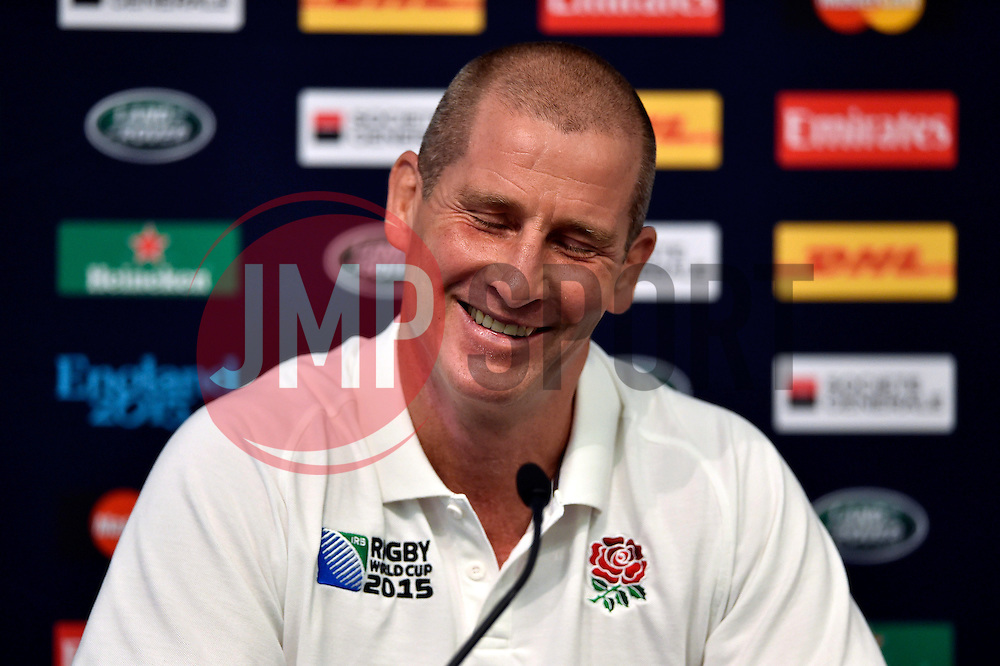England Head Coach Stuart Lancaster reacts to birthday wishes from the media at a press conference - Mandatory byline: Patrick Khachfe/JMP - 07966 386802 - 09/10/2015 - RUGBY UNION - Manchester City Stadium - Manchester, England - England Captain's Run - Rugby World Cup 2015.