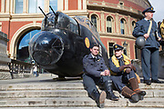 UNITED KINGDOM, London: 26 February 2018 <br /> WWII re-enactors sit next to a 23 foot Lancaster Bomber replica in front of The Royal Albert Hall this morning to mark the 75th anniversary since 'Operation Chastise' was given final approval. It also comes before a gala screening of The Dam Busters which will be shown in May to make the occasion.<br /> Photograph: Rick Findler