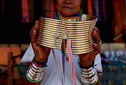 A Padaung woman with brass rings around her neck shows a set of brass rings at her gift shop in Panpet Village, Demoso Township, Kayah State, Myanmar, April 11, 2016. The brass rings are first applied when the Padaung girls are about eight years old and as the girl grows older, longer coils are added up to 24 or 25 rings. EXPA Pictures © 2016, PhotoCredit: EXPA/ Photoshot/ U Aung<br /> <br /> *****ATTENTION - for AUT, SLO, CRO, SRB, BIH, MAZ, SUI only*****