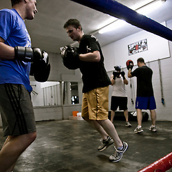 Boxing class and mitt drills at Sweet Z's Boxing Gym in Kansas City, Kansas.