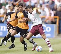 Photo: Jonathan Butler.<br /> Barnet v Arsenal. Pre Season Friendly. 14/07/2007.<br /> Robin Van Persie of Arsenal hands off Joe Devera of Barnet.