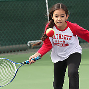 March 1, 2014, Palm Springs, California: <br /> A girl plays tennis during Kids Day at the Indian Wells Tennis Garden sponsored by the Coachella Valley National Junior Tennis and Learning Network.<br /> (Photo by Billie Weiss/BNP Paribas Open)