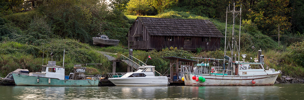 Fishing boats tied up on a dock along Bedford Channel - on the Fraser River in Langley, British Columbia, Canada