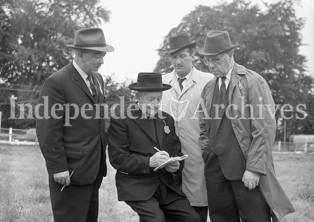 29593<br /> In the cattle judging ring at Longford Show were, from left: Mr P.Trapp (Steward), M.J. Connolly P.P., Scotstown, President Irish Shorthorn Association, Mr Michael Looby, Livestock Inspector for Longford and Mr John Beatty, Chief Livestock Inspector Dept of Agriculture. 13/8/1964. (Part of the Independent Ireland Newspapers/NLI Collection)