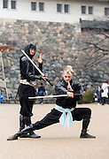 """Chris  """"Sora"""" O'Neil and Sanpei pose for a photo in the grounds of Nagoya Castle, Aichi Prefecture Japan on Feb. 23, 2017. O'Neil is one of the eight ninja corps who roam the avenues of the castle and Nagoya Airport, jumping from behind trees and bushes to surprise visitors. ROB GILHOOLY PHOTO"""