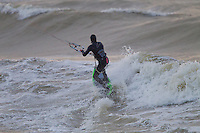 Kitesurfers and Windsurfers at Tide Mills, East Sussex on one cold and very gusty Sunday morning
