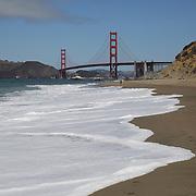 The Golden Gate bridge is seen in the background of Baker Beach in San Francisco, California on Sunday, August 24, 2014. (AP Photo/Alex Menendez)