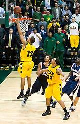 January 30, 2010; San Francisco, CA, USA;  San Francisco Dons guard Rashad Green (13) shoots a layup in overtime to seal the victory over the Gonzaga Bulldogs at the War Memorial Gym.  San Francisco defeated Gonzaga 81-77 in overtime.