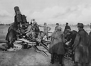World War I 1914-1918: Austrian mortar about to be loaded by its gun crew, 1915. Military, Army, Soldier, Artillery
