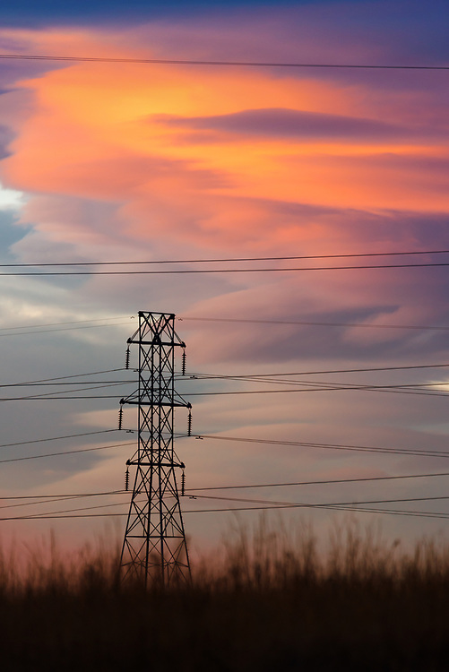 A picture of some power lines during a dramatic sunset in Colorado.<br /> <br /> Camera <br /> NIKON D610<br /> Lens <br /> 150.0-600.0 mm f/5.0-6.3<br /> Focal Length <br /> 600<br /> Shutter Speed <br /> 1/80<br /> Aperture <br /> 6.3<br /> ISO <br /> 500